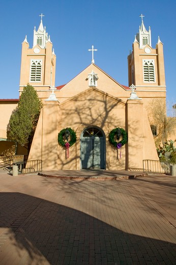 San Felipe de Neri Catholic Church is on the National and State registers of historic places, is located in the Old Town of Albuquerque, New Mexico and began services in 1794 : Stock Photo
