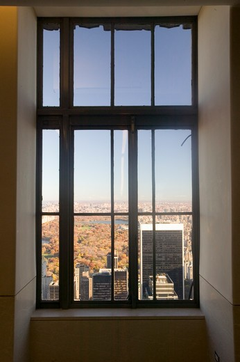 Stock Photo: 1599R-25420 New York City view through window of ?Top of the Rock? viewing area at Rockefeller Center, New York City, NY