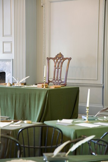 Stock Photo: 1599R-26084 Restored Assembly Room with Rising Sun Chair of George Washington, Independence Hall, Philadelphia, Pennsylvania, one of the meeting places of the Second Continental Congress, where the Declaration of Independence and the Constitution were also debated, adopted, and signed. Future Presidents Washington, John Adams, Jefferson, Madison, and Monroe helped found the Nation in this room.