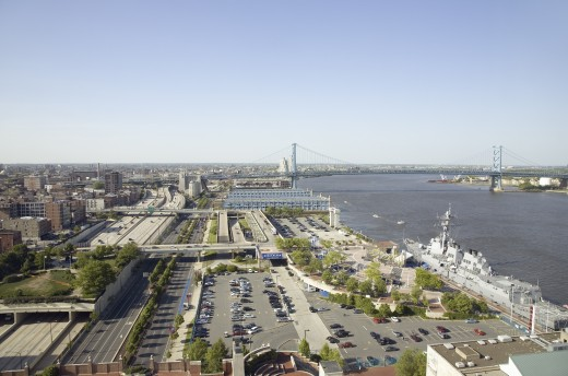 Aerial view of Delaware River, Benjamin Franklin Bridge and waterfront of Philadelphia, Pennsylvania shot from Penns Landing : Stock Photo