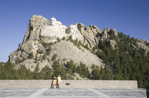 A man and woman at the Grand Terrace view of Mount Rushmore National Memorial, South Dakota : Stock Photo