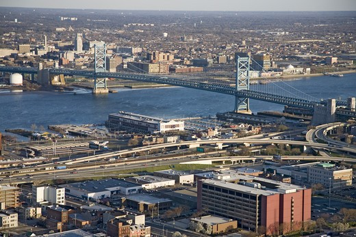 Aerial view of Ben Franklin bridge crossing the Delaware River from Philadelphia, Pennsylvania side into Camden New Jersey : Stock Photo