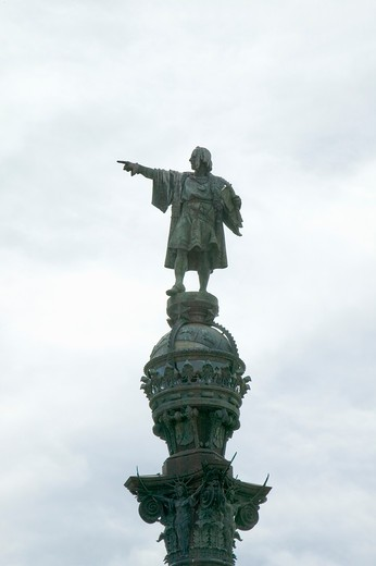 Statue of Christopher Columbus points west over Atlantic Ocean to New World, waterfront of Port Vell, Barcelona, Spain : Stock Photo
