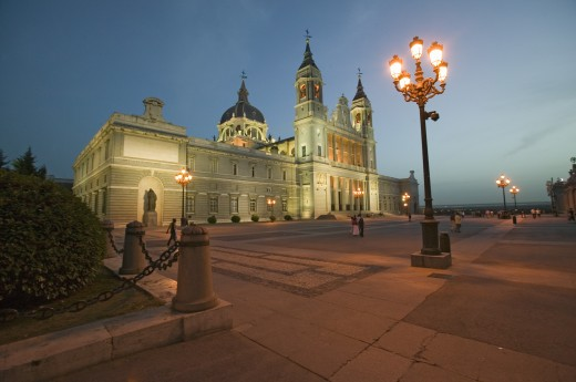 Twilight and lights coming on at Royal Palace in Madrid, Spain : Stock Photo