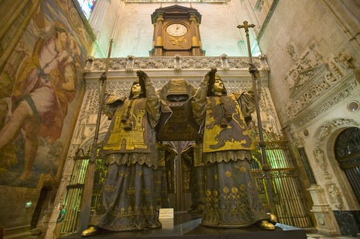 Stock Photo: 1599R-29216 In the Sevilla Cathedral, Southern Spain, is the mausoleum-monument and ornate tomb of Christopher Columbus where four heralds dressed in full court mourning carry the sarcophagus; they bear respectively the arms of, Castile, Léon, Aragon, and Navarre, the four nations which united under the rule of Ferdinand and Isabella, constituted the kingdom of Spain. The sarcophagus is of bronze, ornamented with enameled metallic plates, and in it are the remains of Columbus, the Discoverer of the New Worl