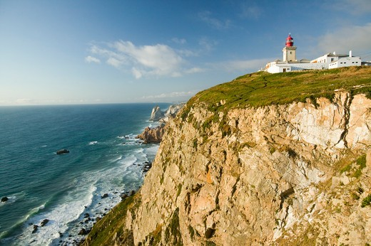 Stock Photo: 1599R-29281 Cliffs and lighthouse of Cabo da Roca on the Atlantic Ocean in Sintra, Portugal, the westernmost point on the continent of Europe, which the poet Camões defined as ''where the land ends and the sea begins''.