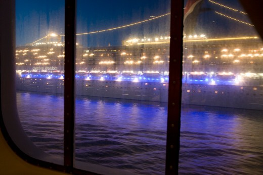 Cruise ship with lights on departing Port of Civitavecchia, Italy, the Port of Rome : Stock Photo