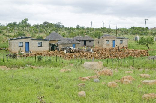 Village houses in countryside of Zululand, South Africa : Stock Photo