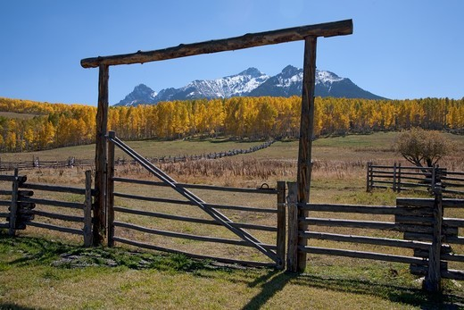 Wooden fence frames San Juan Mountains, Last Dollar Ranch, Hastings Mesa, near Ridgeway, CO : Stock Photo