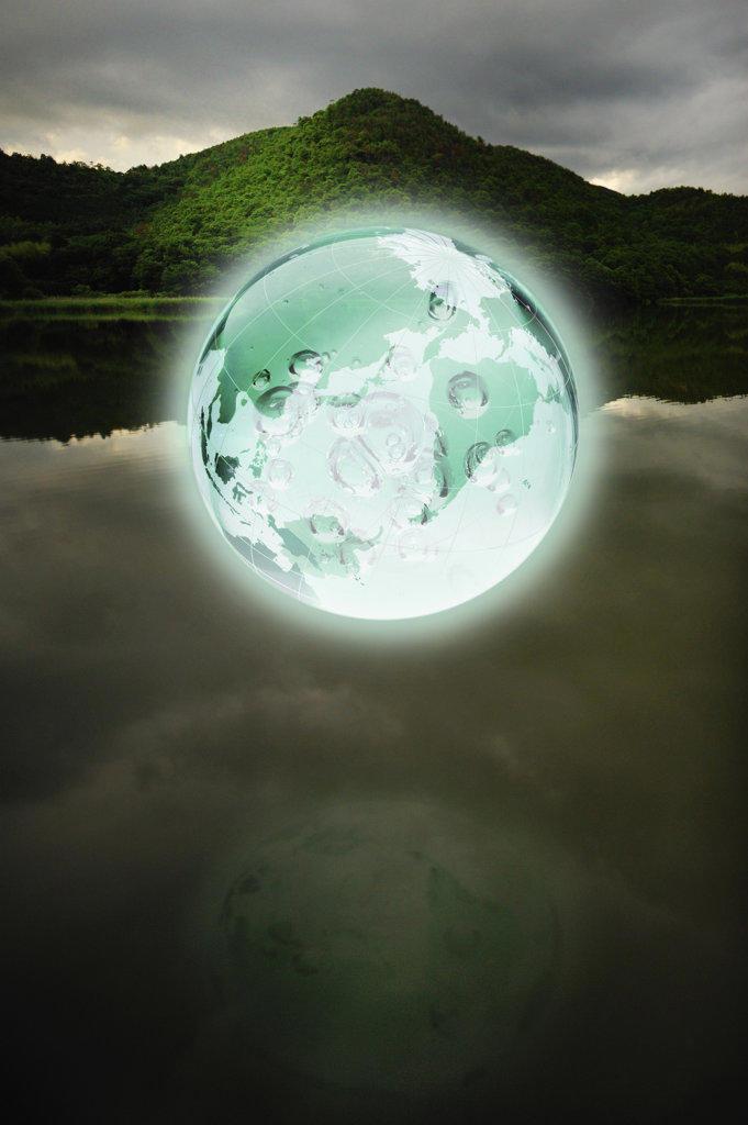 Glowing Earth over lake : Stock Photo