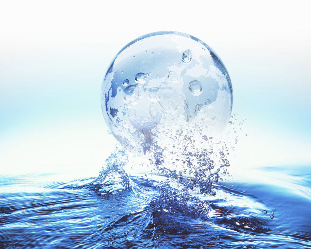 Globe on surface of water, digitally generated image : Stock Photo