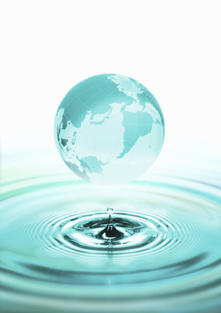 Globe above surface of water, digitally generated image : Stock Photo
