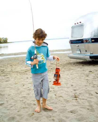 Stock Photo: 1606-101080 Boy with fishing rod and storm lantern