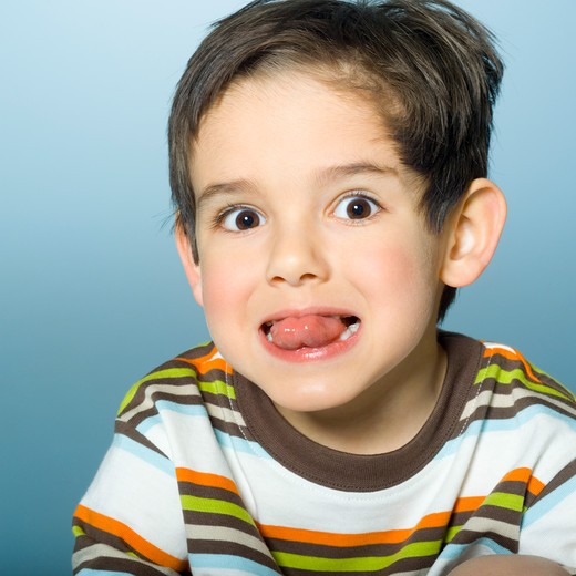 Stock Photo: 1606-101323 Portrait of little boy sticking out tongue