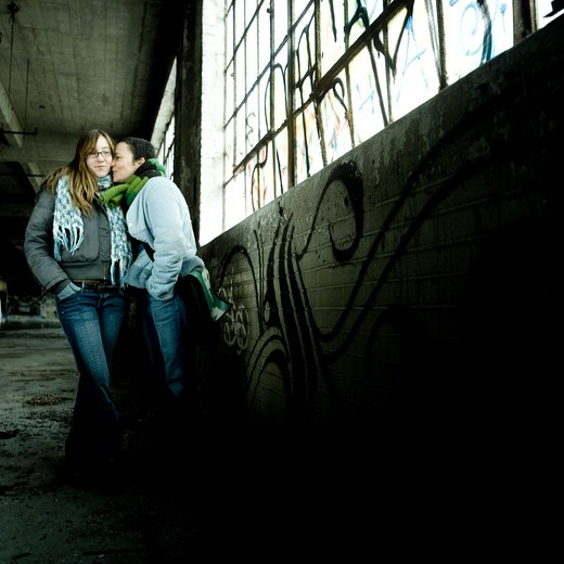 Woman and teenage girl in disused plant : Stock Photo