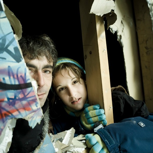 Portrait man and teenage girl in disused plant : Stock Photo