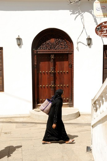 Stock Photo: 1606-103046 Tanzania, Zanzibar island, Zanzibar City, woman walking in the street