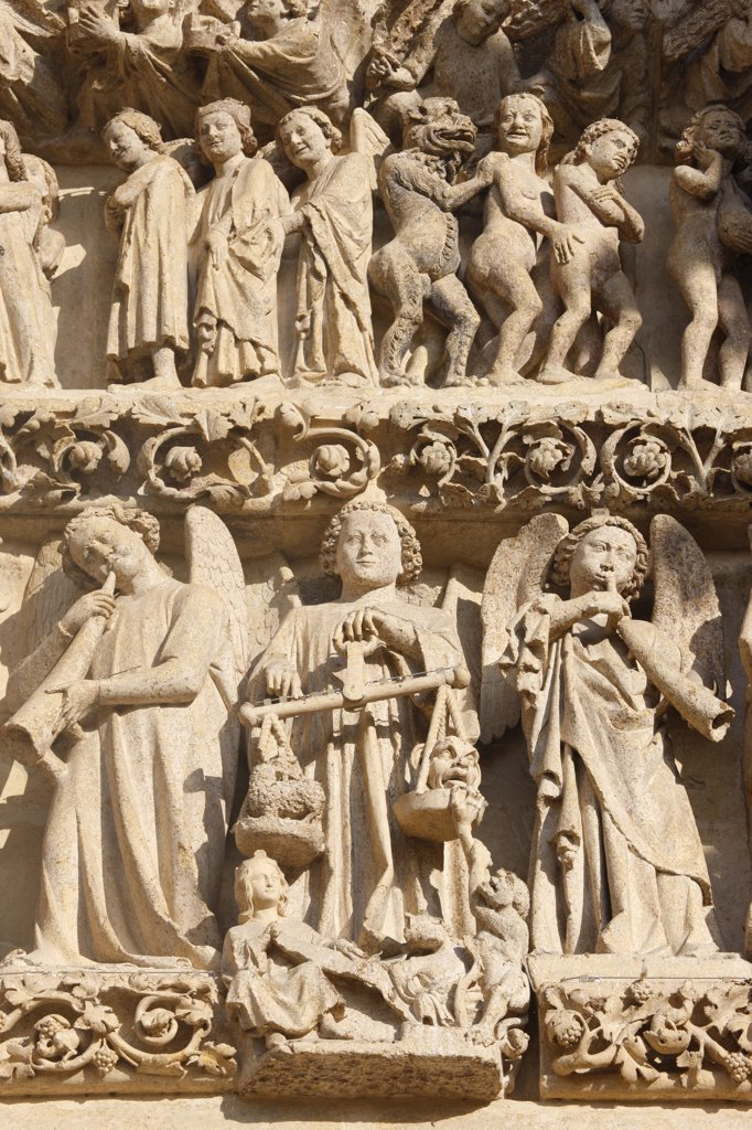France, Somme, Amiens, Amiens cathedral. Central gate Last judgment tympanum   Saint Michael and the weighing of souls : Stock Photo