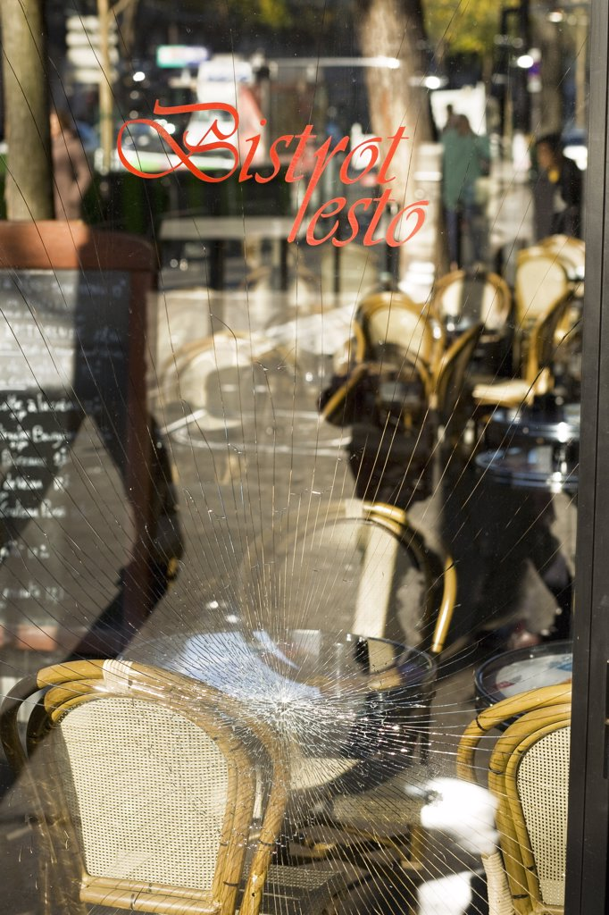 France, Paris, Avenue des Gobelins, broken window-pane of a caf : Stock Photo