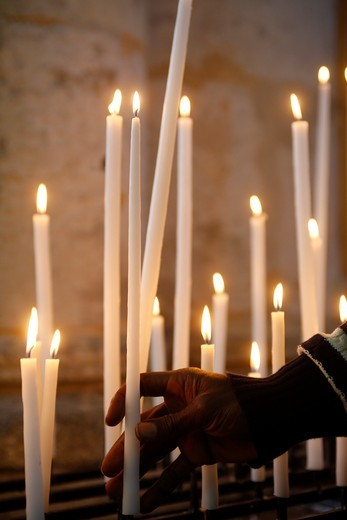Stock Photo: 1606-111983 France, Somme, Amiens, Man praying with candles in church