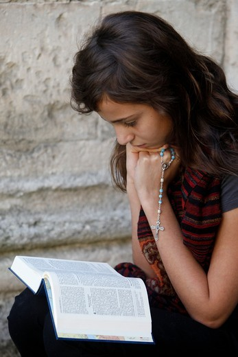 France, Bouches-du-Rh?ne, Arles, Girl reading the Bible : Stock Photo