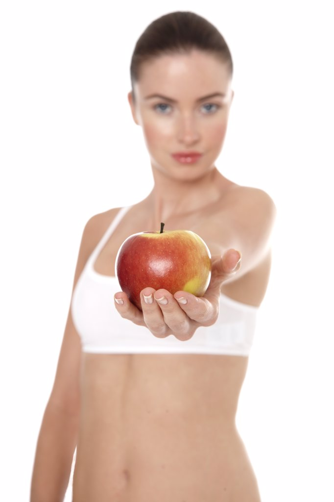 Woman in underwear holding apple : Stock Photo