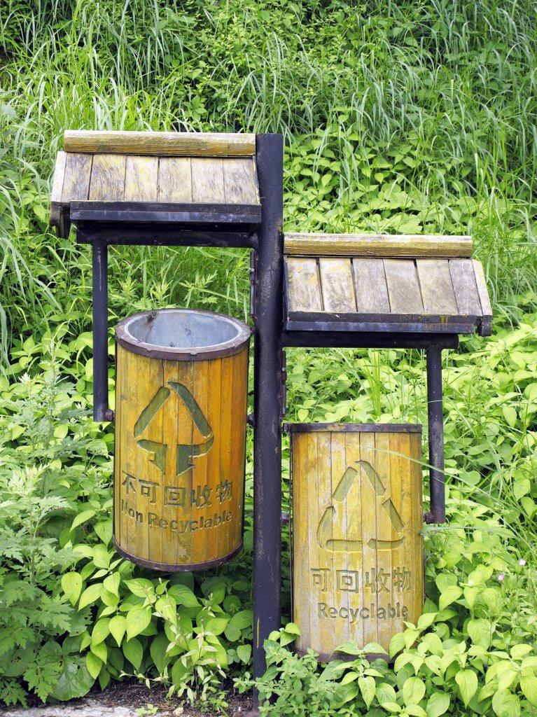 China, Yunnan province, Lijiang, recycling bins : Stock Photo
