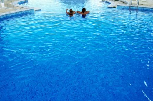 Stock Photo: 1606-11424 Polynesia, Tahiti, couple in pool, rear view