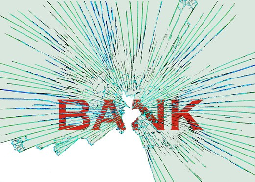 Broken glass and bank sign : Stock Photo