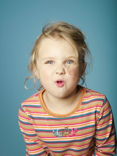 Portrait of little girl making a face : Stock Photo