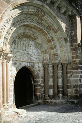 France, Midi Pyrenees, Aveyron, Espalion, romanesque church, south door : Stock Photo