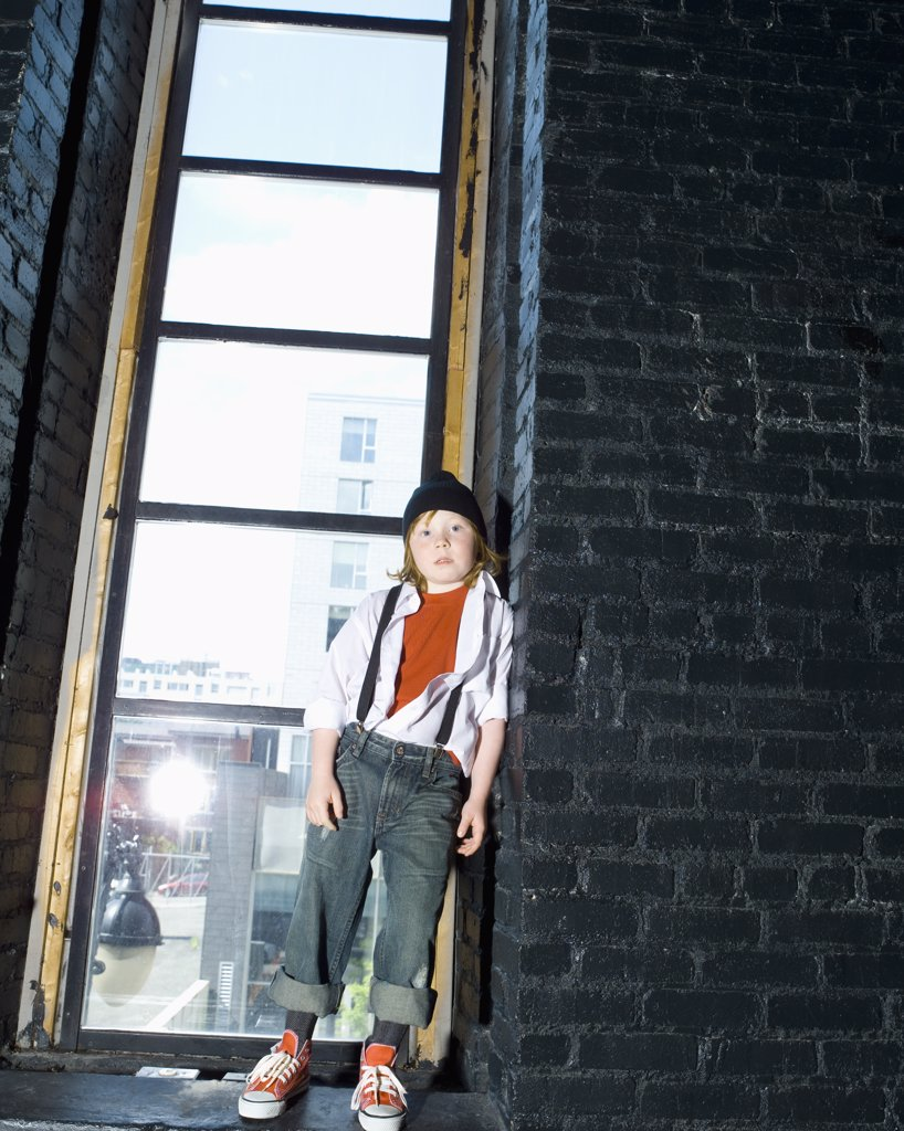 Stock Photo: 1606-120077 Boy leaning against wall