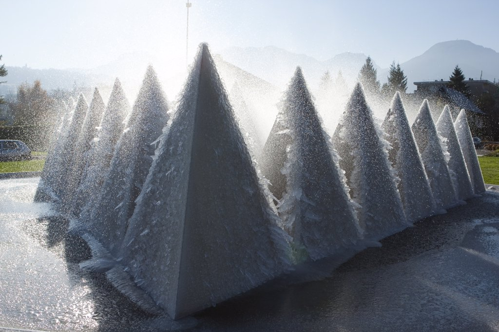France, Alps, Savoie, Chamb?ry, frozen structures in a roundabout : Stock Photo