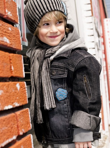 Little boy standing on windowsill : Stock Photo