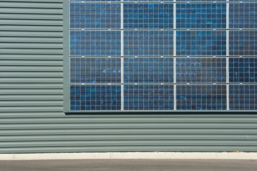 Southern France, solar panels on factory fa?ade : Stock Photo