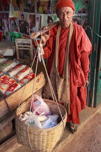 Stock Photo: 1606-126786 Myanmar, Burma, Kalaw, buddhist monk in the market