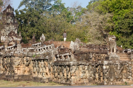 Cambodia, Siem Reap, Siem Reap, Architectural Sculpture of Naga, Lion Guardians and Figures on Elephant Terrace at Angkor Thom   Cambodia. : Stock Photo