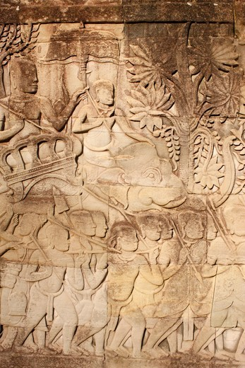 Cambodia, Siem Reap, Siem Reap, Elephants and warriors. Relief Sculpture on the East Outer Gallery at Bayon.  Cambodia. : Stock Photo