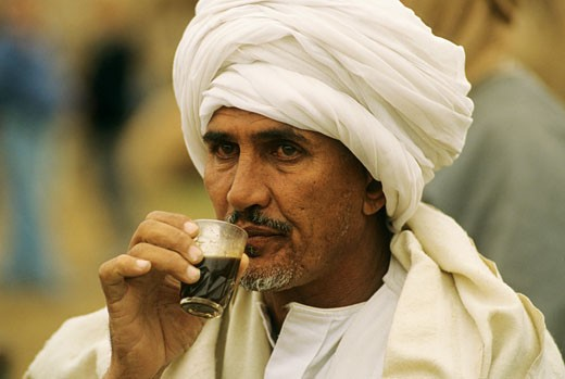 Egypt, El Cairo, Imbaba, portrait of a man drinking coffee : Stock Photo