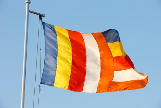 Stock Photo: 1606-127921 Cambodia, Phnom Penh, Buddhist flag in Phnom Penh.   Cambodia.