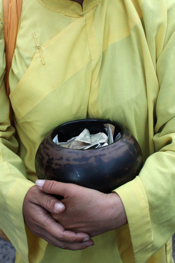 Vietnam, Ho Chi Minh City, Nun's alm bowl Vietnam. : Stock Photo
