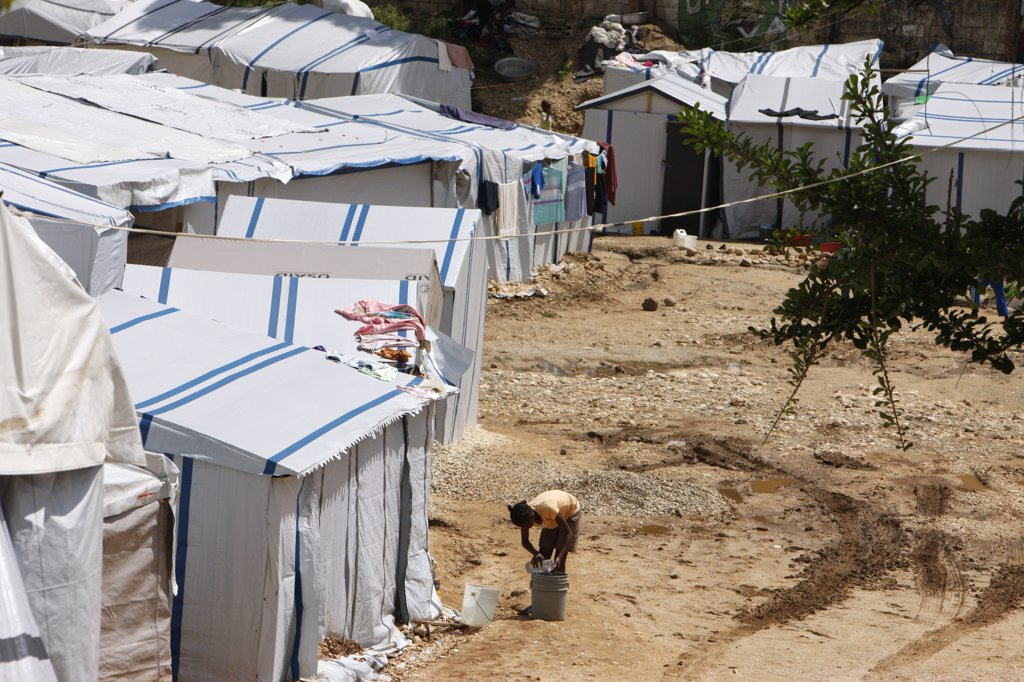 Haiti, Port-au-Prince. Camp for persons displaced by the 2010 earthquake Haiti. June 2010. : Stock Photo