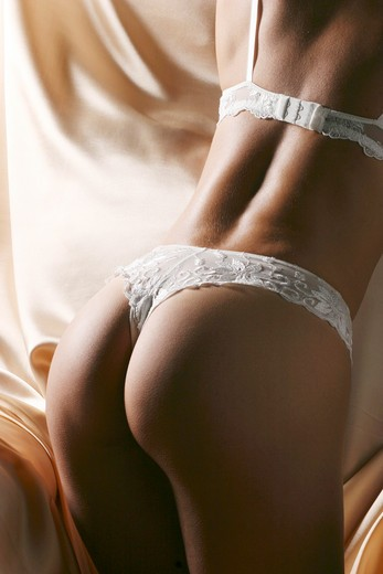 Stock Photo: 1606-130447 Woman in white lingerie