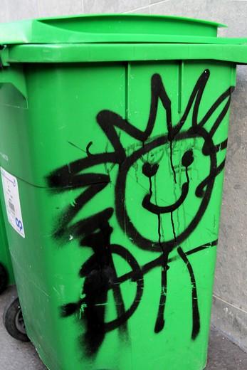 France, Paris, graffitis on dustbin : Stock Photo