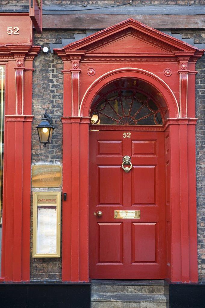 England, North Yorkshire, York, red door : Stock Photo