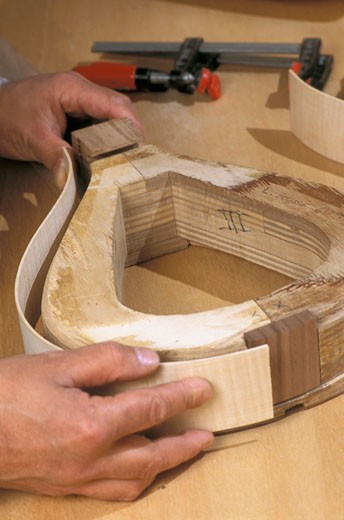 France, Corsica, Pigna, stringed instrument maker, close-up : Stock Photo