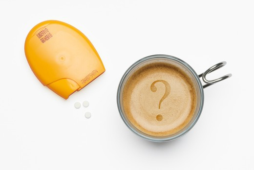 Sweeteners and coffee cup : Stock Photo