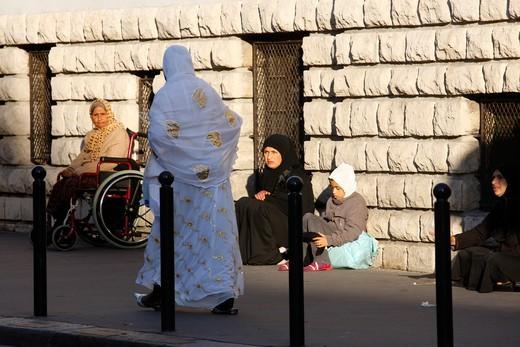 Stock Photo: 1606-136425 France, Ile-de-France, Paris. Zakât El Fitr : alm giving outside a mosque France