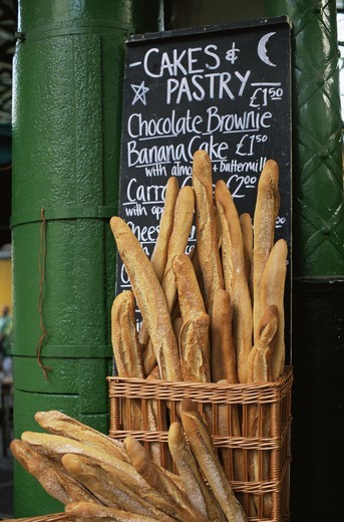 Stock Photo: 1606-142348 England,London,Southwark,Borough Market,Bread Stall,Basket of Baguettes