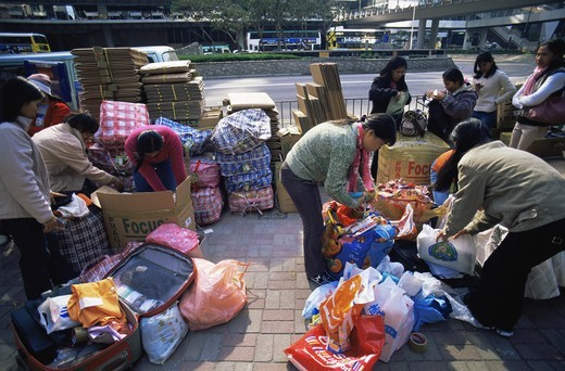 Stock Photo: 1606-143104 China,Hong Kong,Central,Female Filipino Domestic Workers Packing Goods for Shipment back to the Philippines